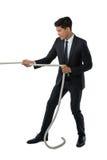 Во всю длину веревочки бизнесмена вытягивая Стоковое Изображение