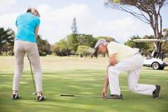 Во всю длину пар игрока в гольф Стоковое Изображение