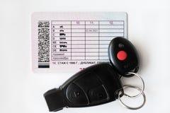 Водительское право и черные ключи автомобиля Стоковая Фотография