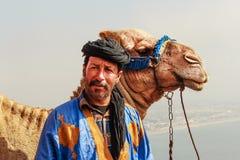 Водитель верблюда с его верблюдом Стоковая Фотография RF
