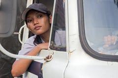 Водитель грузовика смотря вне открытое окно Стоковые Фото
