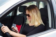 Водитель женщины в ее автомобиле Стоковая Фотография RF