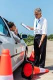 Водитель учащийся извиняясь Стоковое фото RF