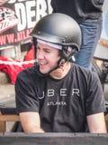 Водитель Uber для красной гонки импровизированной трибуны Bull Стоковое фото RF