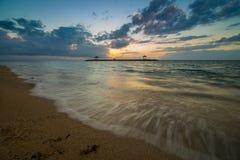 Волна и восход солнца Стоковые Изображения