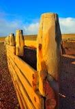Волнорез искупанный в солнечности зимы Стоковые Фотографии RF