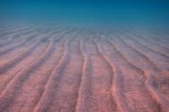 Волны зашкурят и море Стоковые Изображения