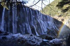 Водопад и радуга стоковые изображения