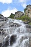 Водопад среди голубого неба Стоковые Изображения RF