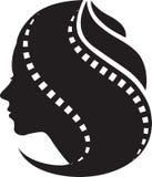 Волосы ленты фильма женщины Стоковое Фото