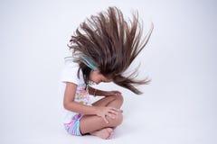 Волосы маленькой девочки бросая вперед Стоковые Фото