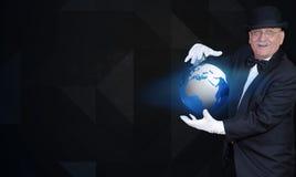 Волшебник показывая глобус, знамя стоковая фотография rf