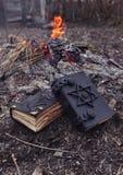 2 волшебных книги в вертикали огня Стоковая Фотография