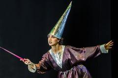 волшебство приниманнсяое за женщиной Стоковые Фотографии RF