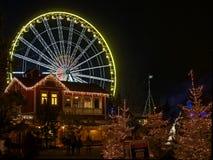 Волшебство рождества на колесе ferris на ноче Стоковые Фото