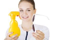 Врачуйте или вынянчите показывать стекла солнцезащитного крема и солнца Стоковое Фото