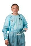 Врач при стетоскоп держа таблетку Изолированная белизна Стоковая Фотография RF