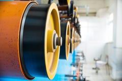 Вращая прорезиновые колеса машины замотки Стоковая Фотография RF