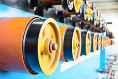 Вращая прорезиновые колеса машины замотки Стоковое Изображение