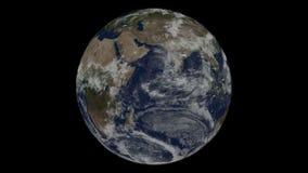 Вращение лоснистой планеты с накаляя частицами акции видеоматериалы