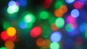 Вращение светов рождества пестротканых defocused сток-видео