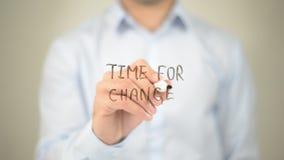 Время для изменения, сочинительства человека на прозрачном экране Стоковое Изображение