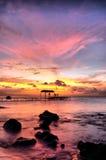 время захода солнца пристани Стоковое Изображение