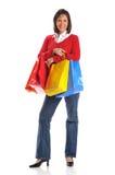 время кладет среднюю женщину в мешки покупкы Стоковое Фото