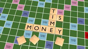 Время кроссворд денег на доске скрэббл Стоковое Изображение RF