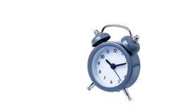Время работы будильника металла на белой предпосылке Стоковая Фотография RF