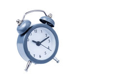 Время работы будильника металла на белой предпосылке 10 am Стоковая Фотография RF
