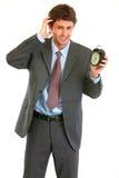 время часов бизнесмена сигнала тревоги concerned Стоковые Фото
