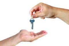 Вручать над ключами Стоковое Фото