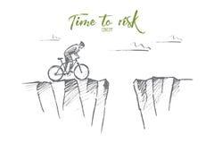 Вручите вычерченного велосипедиста готового для того чтобы рискнуть и поскакать над зазором Стоковое фото RF