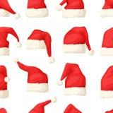 Вручите вычерченную безшовную картину с шляпами рождества на белой предпосылке Стоковое фото RF