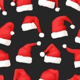Вручите вычерченную безшовную картину с шляпами рождества на темной предпосылке Стоковое Изображение RF