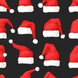 Вручите вычерченную безшовную картину с шляпами рождества на темной предпосылке Стоковые Фотографии RF