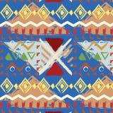 Вручите вычерченную племенную красочную безшовную картину на голубой предпосылке Стоковые Изображения RF