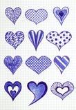 Вручите вычерченные сердца на листе checkered бумаги Стоковая Фотография