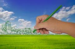 Город чертежа руки на поле Стоковые Фото
