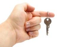 Вручите держать ключа изолировано на белой предпосылке Стоковые Изображения RF