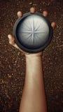 Вручите держать компас Стоковые Фото