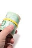 Вручите держать крен 20 долларов канадский Стоковая Фотография RF