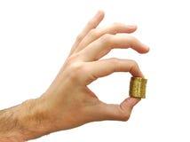 Вручите держать некоторые монетки евро изолированный на белизне Стоковые Изображения RF