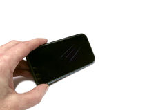 Вручите держать родовой черный мобильный телефон с сломленным экраном изолированный Стоковое Фото