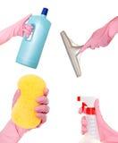 Вручите держать тензид, жидкость, скребок и губку Стоковые Фото