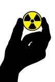 вручите знак радиации Стоковая Фотография