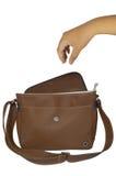 Вручите достижение в коричневую сумку Стоковая Фотография RF