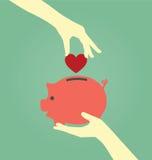 Вручите установку красного сердца в копилку Стоковые Изображения RF