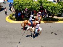 Всадники лошади на Enrama de Сан Isidro Лабрадор в Comalcalco Табаско Мексике стоковая фотография